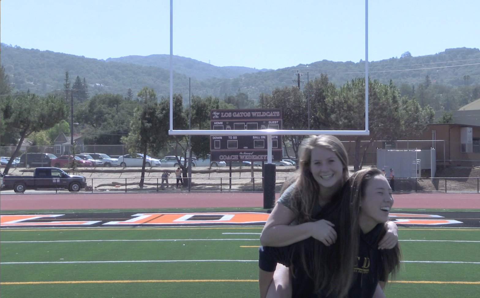 Good friends seniors Sammy Walker and Cammi Johnson film their portion of the video together
